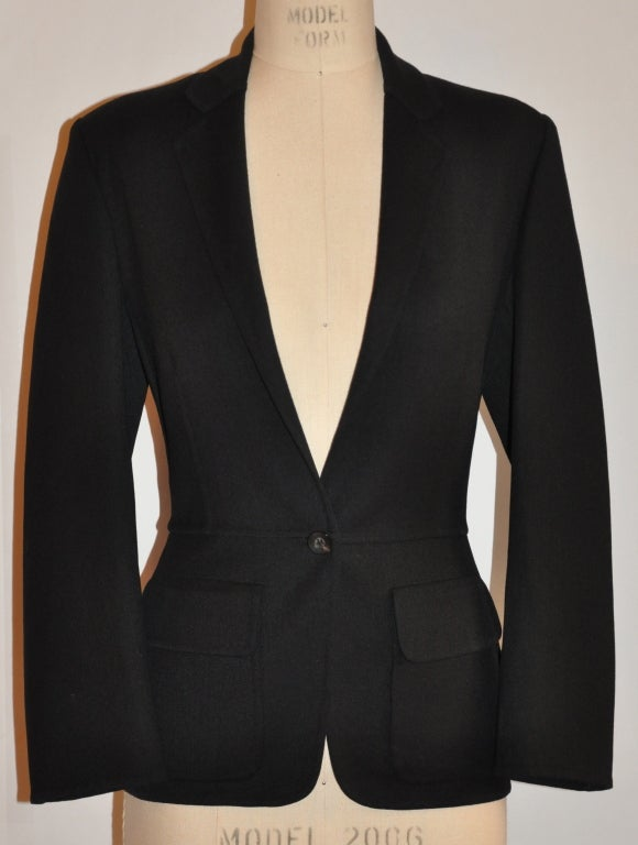 "This Gucci black blazer has such wonderful details inside and out. The interior is done with the ""French seams"" technique and then is hand-sewn so that all the seams lay flat. The armholes are hand-sewn and covered in black-silk ribbon to covered"