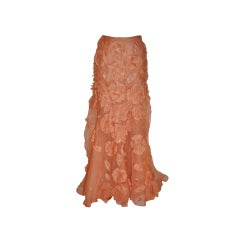 Peach silk organza skirt with floral patches.