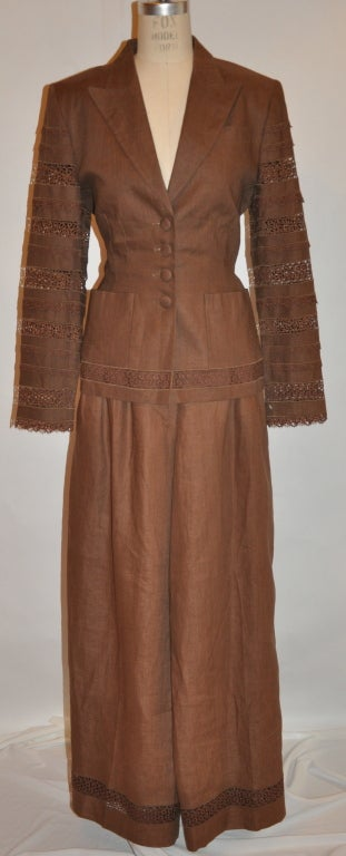 Lolita Lempicka fully lined brown linen and flax blend pant ensemble is wonderfully detailed with handmade Swiss lace throughout. The ensemble is fully lined with silk of the same brown hue. There are two patch pocket in front and one breast