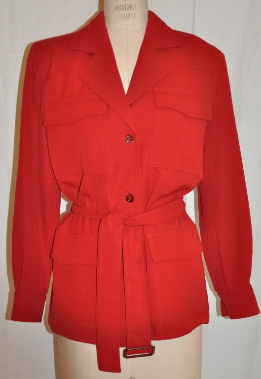 """Angelo Tarlazzi red safari jacket comes with a self-tie belt of the same material. The three-button front has patch pockets. The jacket is detailed with 'French-seams' throughout and supreme top stitching.   The length of the jacket is 27 1/2"""","""