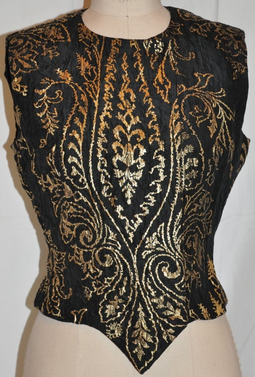 This wonderfully elegant evening top has hidden silk covered snaps (five in all). The black silk evening top with metallic gold accents in a leaf motif can be worn as shown, or with the front half-way open. 