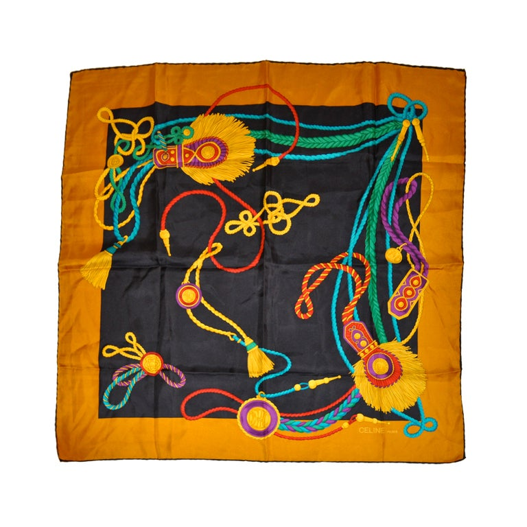 Celine silk scarf with gold borders.