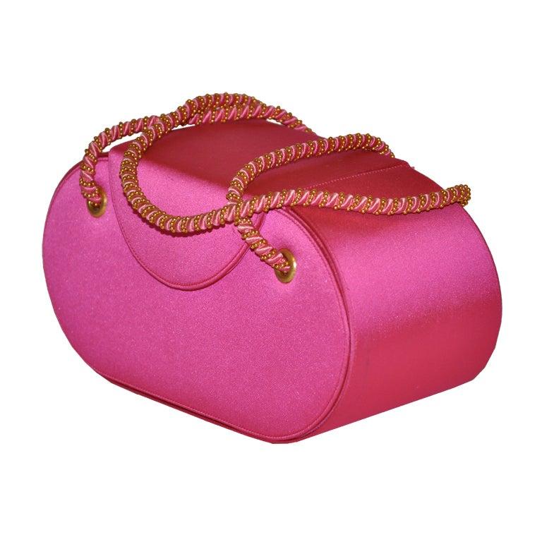 Renaud Pellegrino Fuchsia silk evening bag with gold hardware