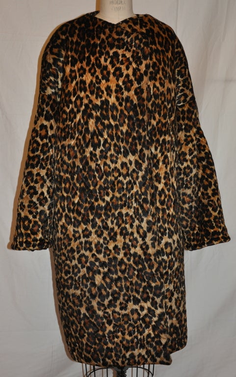 "This wonderful rare Patrick Kelly's quilted leopard-print ""open"" coat overlaps in the front. The quilted coat is high-weight, yet warm. The shoulders are padded and there are two hidden side pockets. The cuffs can be worn as seen or folded up."