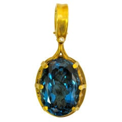 Stunning 40 Carat London Blue Topaz Gold Hand-Carved Pendant