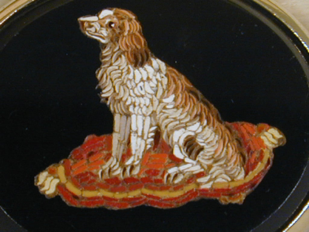 Antique micro-mosaic brooch depicting a King Charles spaniel set in silver gilt. Micro-mosaic jewelry and objects originated in Rome and became fashionable during the age of the grand tour.