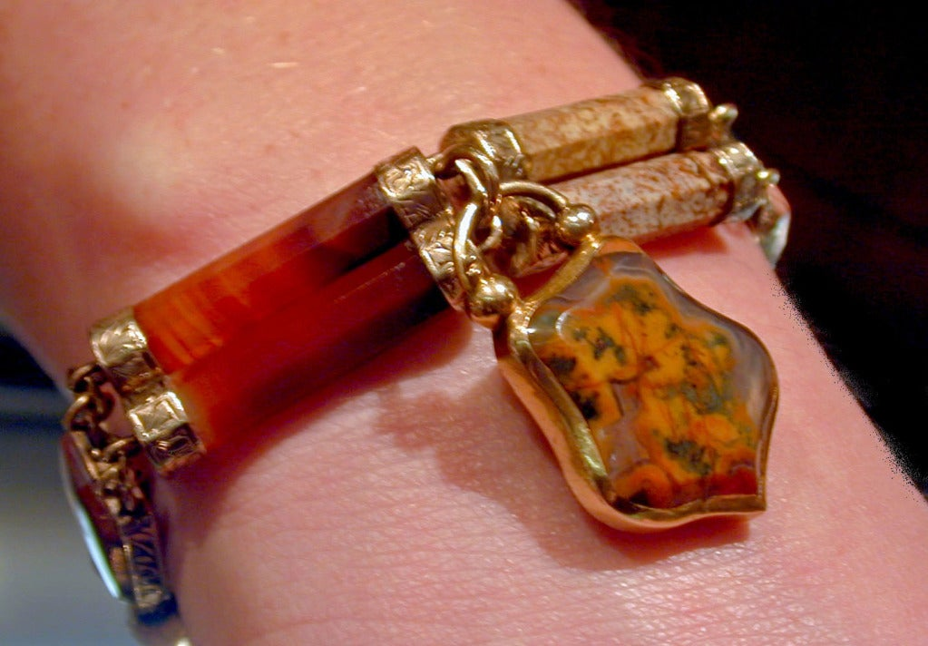 15K Scottish agate padlock bracelet with a locket back has engraved links. Scottish agate jewelry became very desirable in the last quarter of the 19th Century.  Queen Victoria frequented her castle in Balmoral and loved all things Scottish which