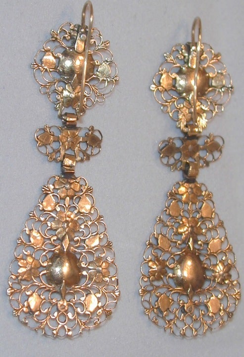 These rare Norman French earrings are made of 18K pierced gold with rose diamonds set in silver rosettes. They are complete with their three parts: round top, bow motif center and pear shaped drops.