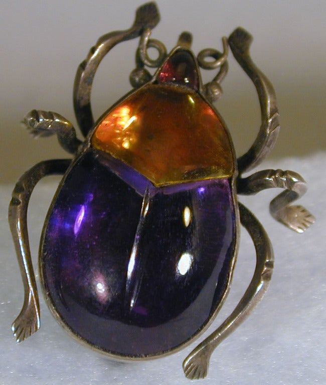 Victorian beetle brooch of foiled crystal set in gilt metal. The wonderfully colored glass will brighten any shoulder or lapel. The bug measures 1 1/8