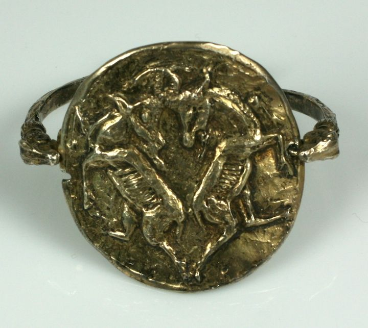 Rare gilt silver Capricorn zodiac cuff by Chanel. A fierce Leo, she loved and repeatedly used zodiac imagery throughout her career. The large center plaque is held by 3 dimensional rams heads with the conjoined legs and hooves forming the bracelet's
