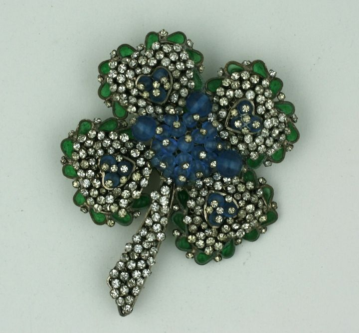 Clovers are another motif Chanel has revisited many times since the 1930s. This elaborate dimensional brooch derives from the Gripoix workshops in Paris. Dozens of rhinestone pegs decorate the heart form petals of the clover. Pale sapphire and