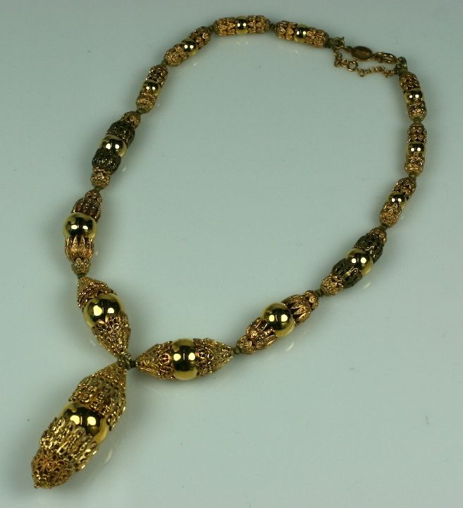 In this necklace the play of multi-toned layered baroque gilt caps against shiny gilt spheres creates an interesting dynamic. This Chanel series was well documented and sold in the period. Combinations of the rich, textural metalwork mixed with