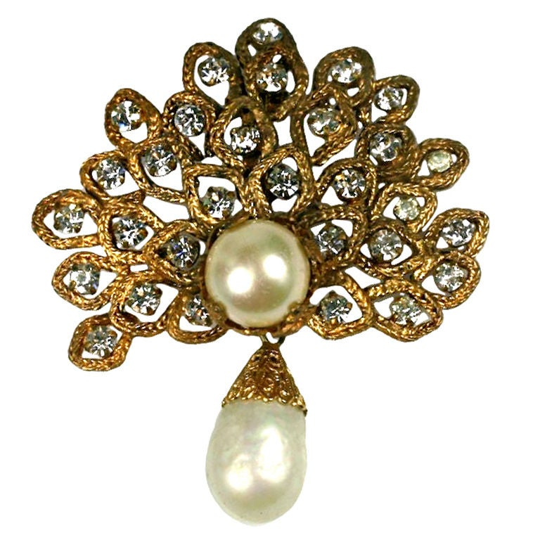 Striking floriform brooch completely handmade by Goossens for Chanel. Chanel's favorite fox chain is transformed into a spray of leaves centered with pastes. The texture of the chaining and antique gold finish are signatures of Chanel's lush