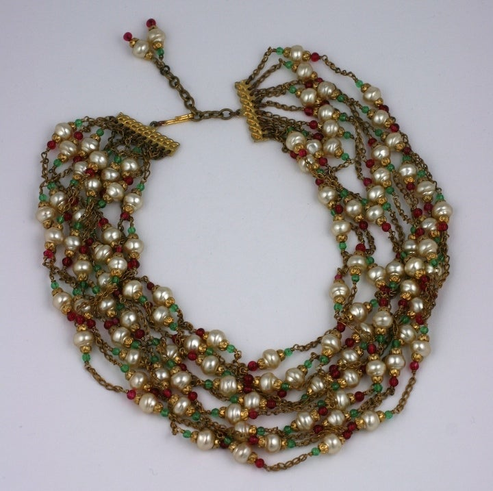Chanel multi chain pearl, emerald and ruby handmade glass collar. Designed by Gripoix mid 1950s to look as though each strand is casually wrapped around the neck, a part of the Chanel idiom of an instictive effortless elegance.
