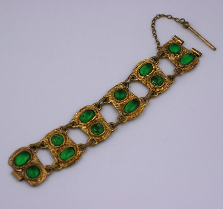 Chanel link bracelet in antique gilt bronze with pate de verre faux emerald cabochons in the Renaissance taste. Handmade in a process unique to Goossens in which the glass is applied from the back as opposed to the front.  The stones look