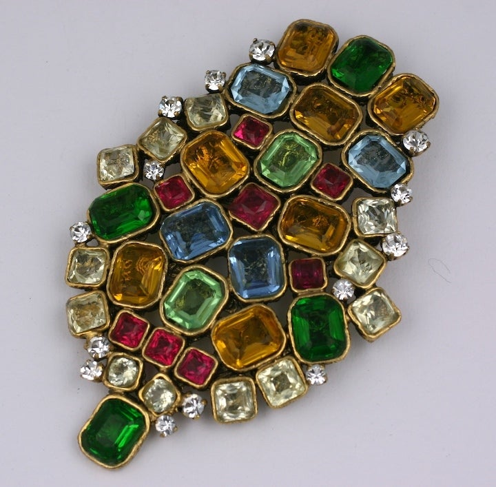 Rare Byzantine Crest Brooch of rectangular and square cut gem colored and crystal foiled stones. This incredibly massive brooch is mounted on a signature filigree back, a device of the Goossens workshop.