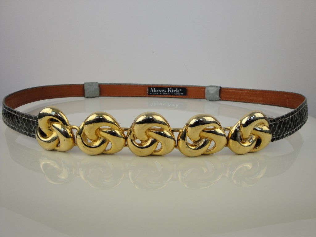 Alexis Kirk olive green lizard belt with gold hardware.