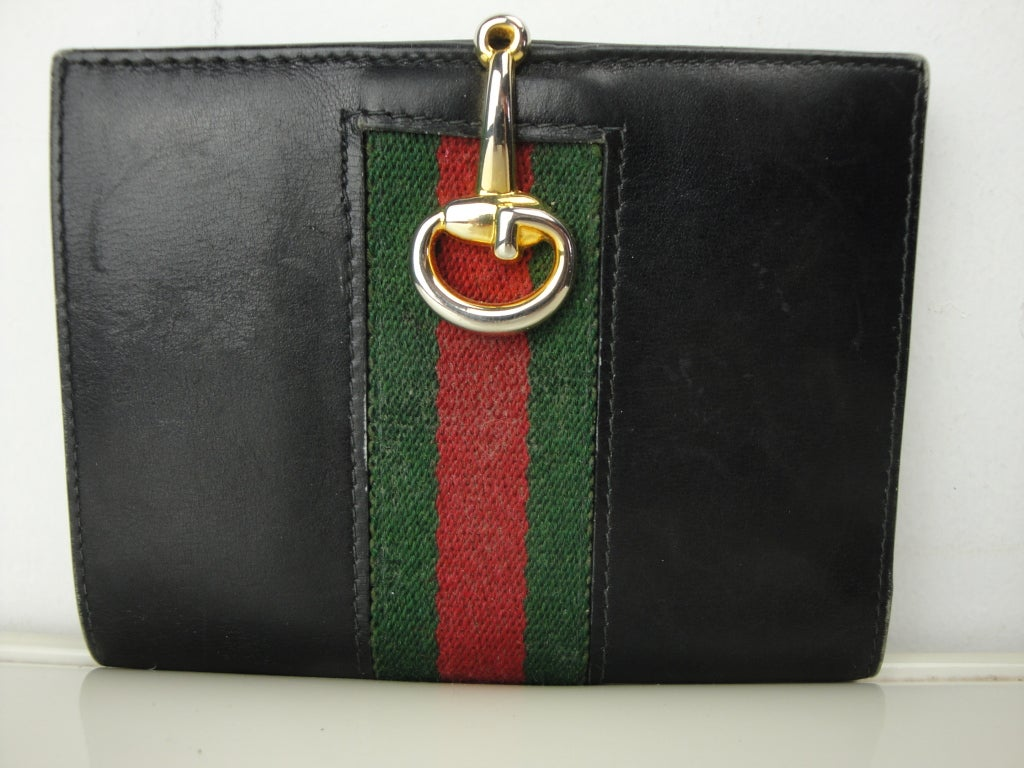 Gucci black leather wallet with green/red/green signature web, one bill compartment,4 card slots and horsebit gold hardware.