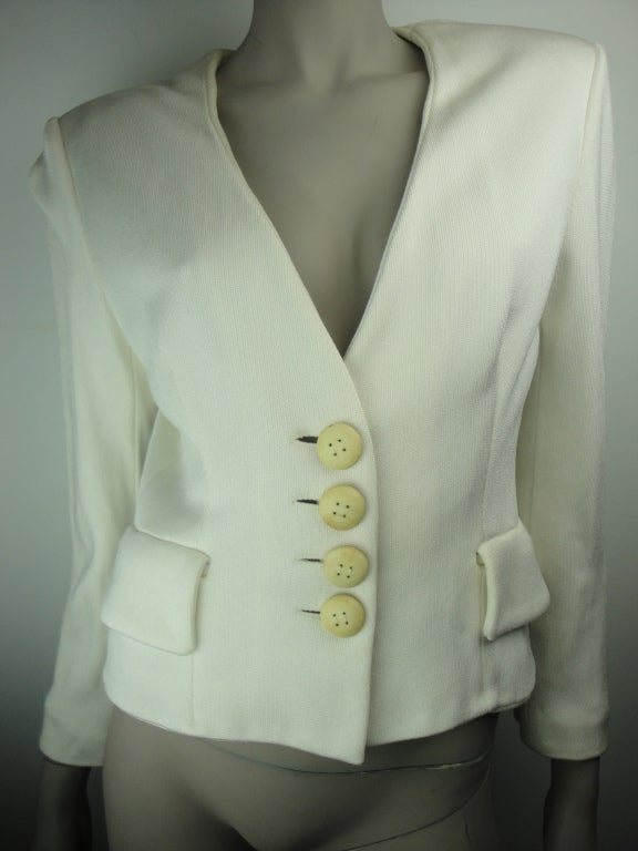 Christian Dior cream jacket,two faux front pockets,four leather buttons and fully lined.