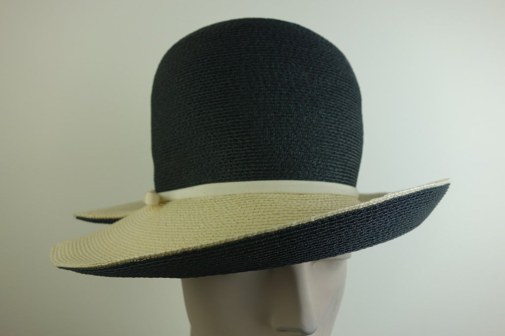 Mr. John Sophisticate black and natural woven straw hat with grosgrain detail.