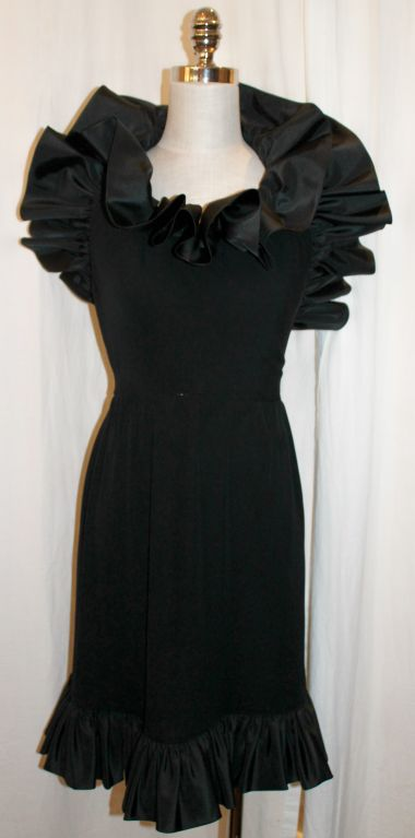 Vintage Nina Ricci Black Crepe & Silk Taffeta Halter Dress with dramatic ruffle detail-Sz 6- 80's.  This item is in very good pre-owned condition.  Measurements are as follows: Waist: 27