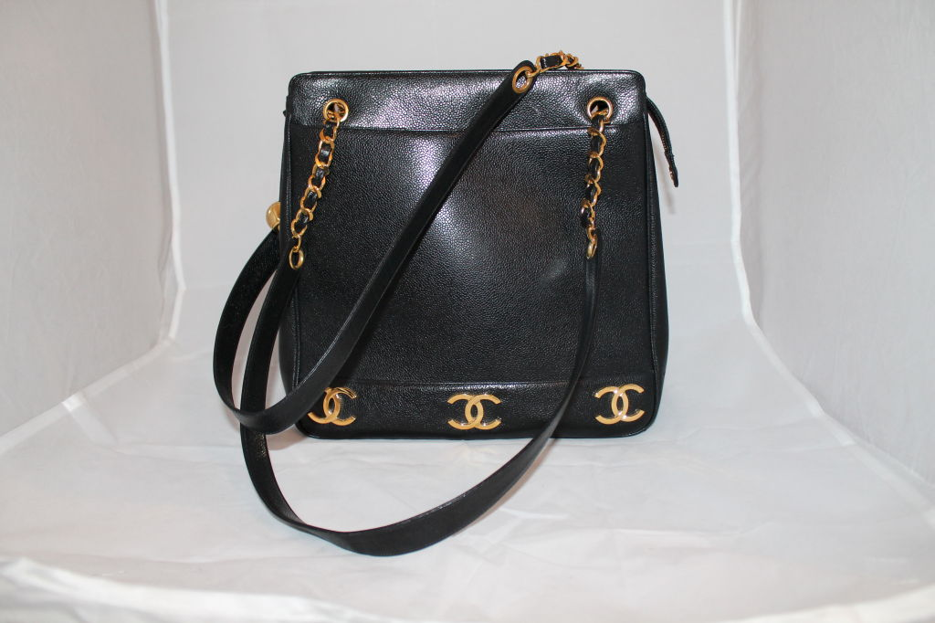 Vintage Chanel Black Caviar Leather Logo Shoulder Bag (Large) 2 Inner pockets and Zipper Closure on Top. Circa 90's. This item is in Excellent Pre-Owned Condition.