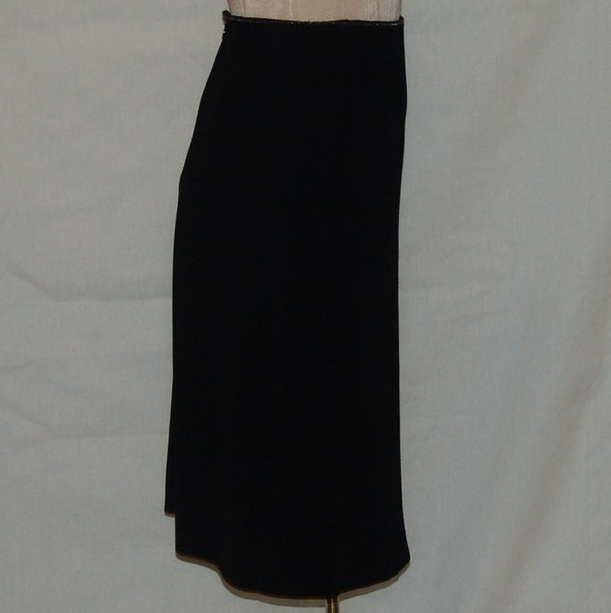 """Chanel black wool skirt with mini link chain at the waist.  Length 24"""", waist 26"""", hips 38"""".  Size 36"""