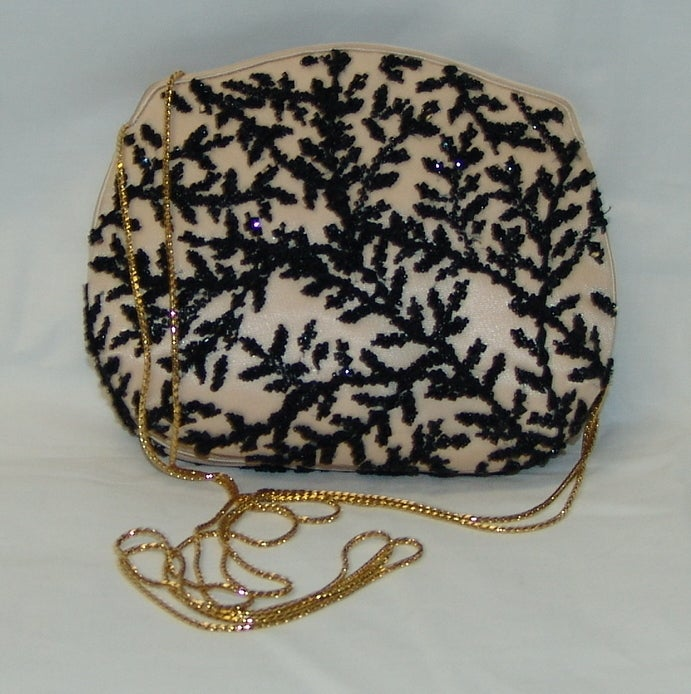 "Judith Leiber pale peach with black beaded design handbag or clutch.  Matching change purse included.  Handle drop 19""."