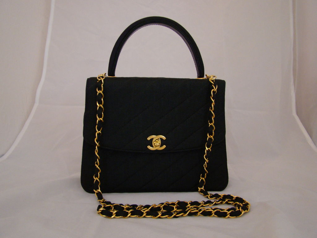 Chanel Black Linen Kelly Bag with detachable Chain Strap. Comes with Authenticity Card and Duster. In Excellent Pre-Owned Condition.Shoulder strap length 22.5