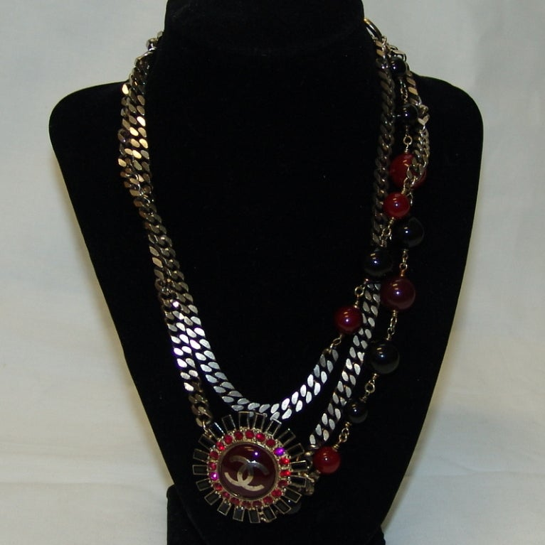 """Chanel Gunmetal Chain Belt/Necklace with Red & Black Stones adjustable. This belt is in excellent condition and is very versatile.   Length 35"""" - 38"""""""
