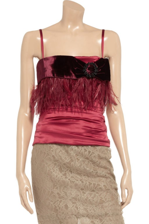 Dolce & Gabbana Red Embellished Corset Top  Dolce & Gabbana deep-red top Stretch-silk satin Velvet trim, bead and feather embellishment, internal molded bra, internal boning Exposed zip fastening through back 86% silk, 4% spandex, 10% feathers