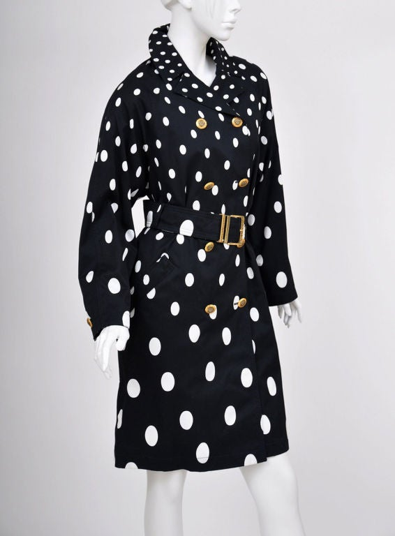 1990-s Gianni Versace Polka Dot Trench Coat. 100% Cotton. Unlined. Finished with iconic Medusa buttons and Greek Key impint on the belt buckle. Size 40. New, with tags.