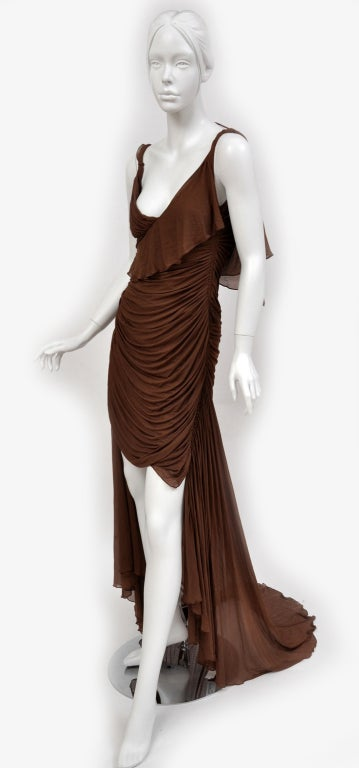 Imbued with feminine charm is a dress crafted from Tom Ford's imagination. Exclusively from the 2003 fall Gucci collection, it has been exhibited in the Metropolitan Museum of Art for its flawless craftsmanship. Composed of delicate silk in