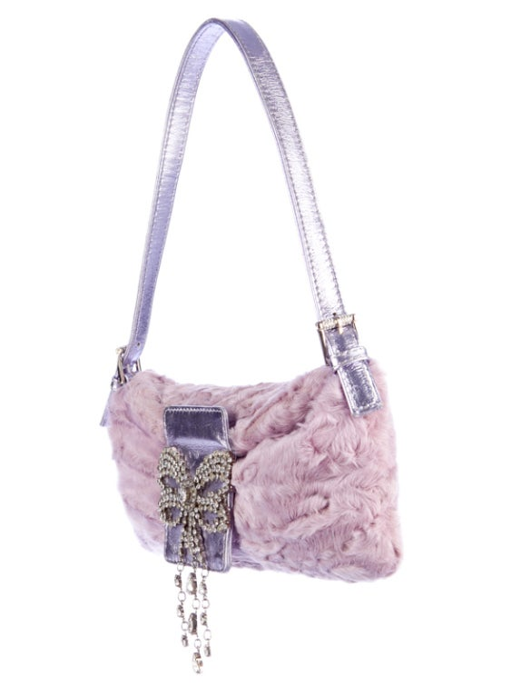 Timeless classic Valentino Baguette. A gorgeous combination of leather, fur and crystals. Adjustable handle allows easy wear over the shoulder. Flap over closure and magnetic snap open.  Approximate size: 5 inches height, 10.5 inches length  MADE IN