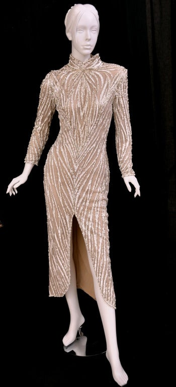 c. 1980's BOB MACKIE Nude Pearl Beaded Gown. This gown is very similar to the design of the costume worn by RuPaul in Mackie's book Unmistakable Mackie   Size 10  Measures: 36 in; bust, up to 30 in. waist, up to 40 in; hips, 54 in. long from