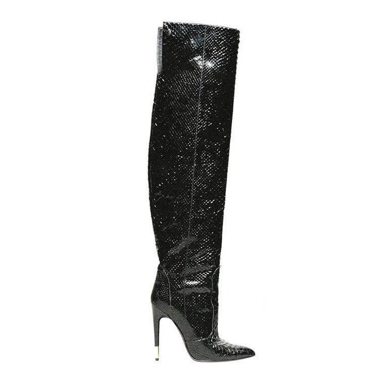 """TOM FORD ANACONDA OVER THE KNEE BOOTS  Looking to make a fierce fashion statement this season? Nothing says it more than the anaconda that forms this Tom Ford stiletto boot.  Genuine anaconda (Argentina). Pointed toe. 4 1/4"""" stiletto heel"""