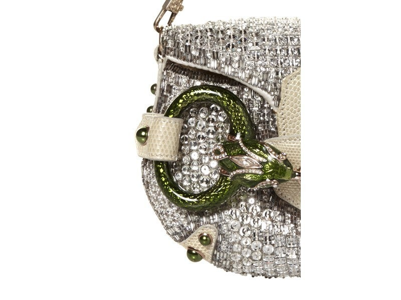 HIGHLY COLLECTIBLE GUCCI CRYSTAL CLUTCH   CREATED BY TOM FORD    Crystal-embellished clutch with enamel snake hardware, removable  strap and magnetic closure at flap.   Includes original dust bag.  Excellent Condition  Dimensions: Height: