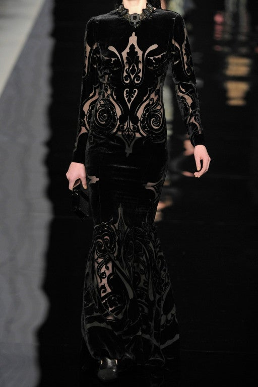Etro's deliciously dark devoré velvet gown. The plunging V-back and semi-sheer baroque pattern lends this demure piece a subtly seductive feel. 