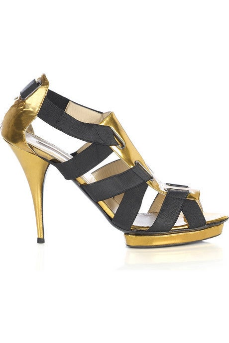 OSCAR DE LA RENTA SHOES Put some sass in your new-season step with Oscar de la Renta's black and gold patent leather bandage sandals. Wear these fabulous look-at-me heels to add the Midas touch to an elegant evening ensemble. Heel measures
