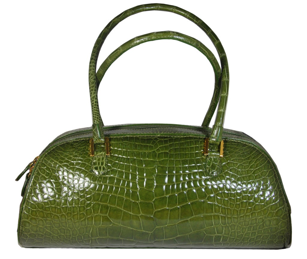 """Gorgeous Lana Marks olive green genuine alligator bag. It has a double zipper closure as well as a zippered and unzippered compartment inside. The measurements are 14 3/4"""" X 7"""" X 3"""", with a 8.5"""" drop handle. Comes with its Detachable shoulder strap"""