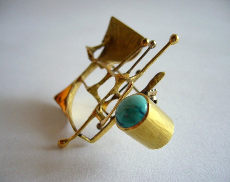 "An 18k yellow gold Italian abstract expressionist brooch featuring a tube mounted Persian turquoise, made in Italy in the 1950's.  Brooch has accents of white gold also.  Measuring 2"" x 1 3/4"" and signed 750.  In excellent vintage condition."