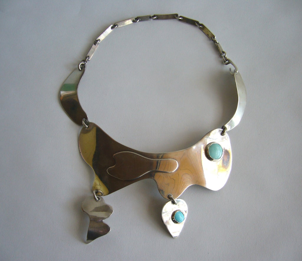 A very rare sterling and turquoise necklace designed by Sam Kramer (1913-1964) of New York City in the late 1940's to early 1950's.  The Kramer studio was located in Greenwich Village along with other modernist studio jewelers of that period,