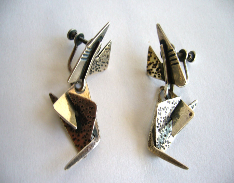 An abstract pair of sterling silver earrings designed by Ed Wiener of New York City.  Wiener was a large part of the abstract expressionist movement and had jewelry studios in Greenwich Village and also in Provincetown, Rhode Island.   Earrings