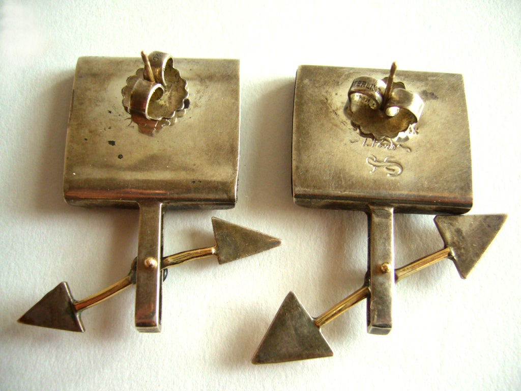 """A pair of kinetic arrow earrings by New York studio jeweler and artist, Tod Pardon. Wood earrings have sterling silver and 14k gold dotted inlay and are made for pierced ears. Measuring 1 3/4"""" in length and signed on the reverse Tod Pardon,"""