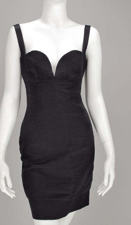 Gianni Versace Couture black corded silk corset dress from the 1990s...This amazing dress features a plunge neckline with trapunto quilted bra cups that are the focus of the bodice with narrow shoulder straps, the back is low and open. The dress is