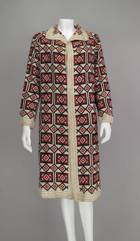 Fabulous geometric woven wool coat from the 1920s, marked made in Hungary, it has the feel of the Wiener Werkstatte in it's coloration and design. Open front coat has a straight shape with long sleeves, trimmed with a cream wool border.  All our