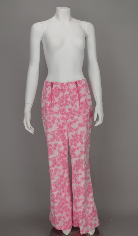 Happy pink daisy print bell bottoms...The Lilly, 1960s by Lilly Pulitzer...double zipper front panels...double patch pockets at back...1960s style hip hugger bell bottoms...fully lined...Measurements are: Waist 27