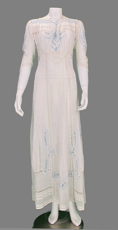 Edwardian embroidered tea or wedding dress in blue and white fine batiste cotton. From the early 1900's it is completely hand made and hand embroidered, it would make a lovely and unique wedding dress. Elbow length sleeves with insets of blue and