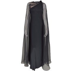 Mollie Parnis one shoulder cape sleeve gown 1970s