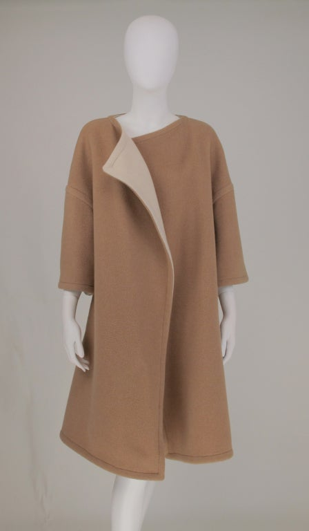 Camel/cream double face wool coat from the early 1960s, dropped shoulder, bracelet length sleeves...open front with no closure...coat is top stitched and reversible...All our clothing is dry cleaned and inspected for condition and is ready to